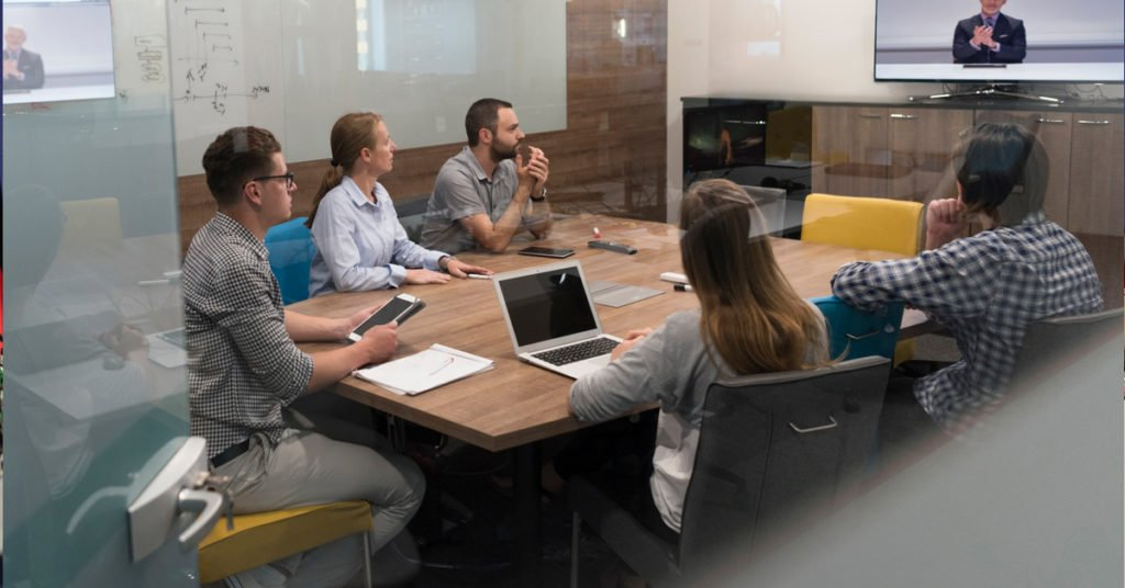 Group of people attending a video conference